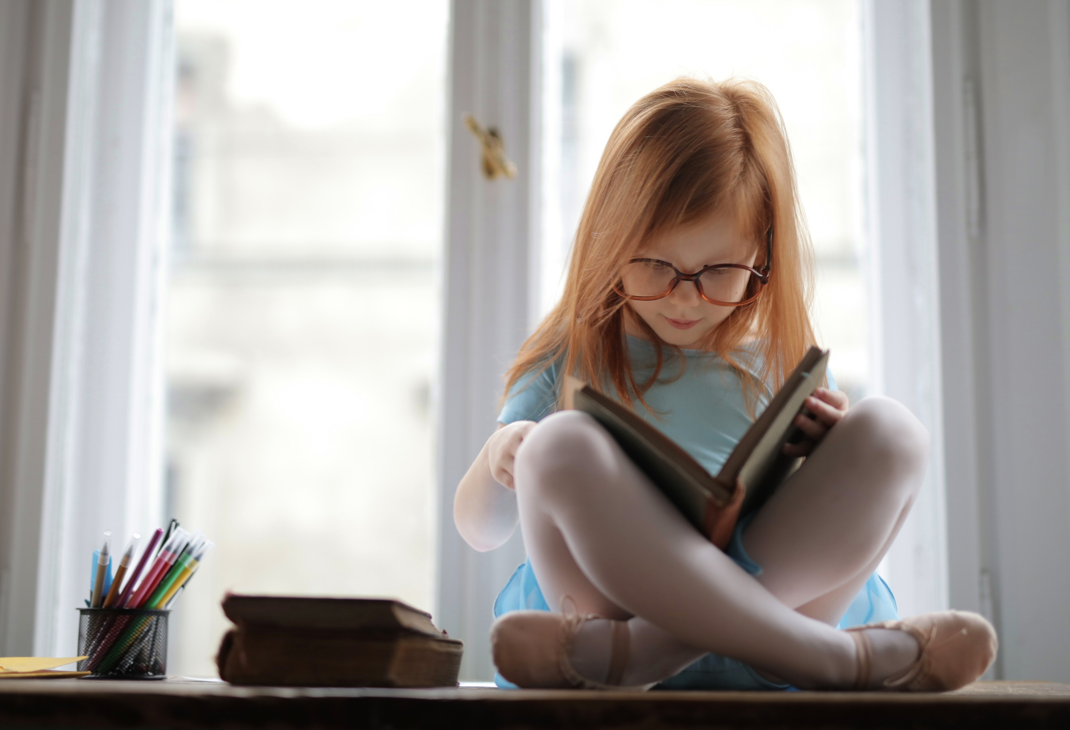 girl in blue dress reading a book 3887493